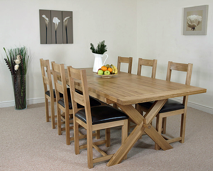 solid oak extending cross leg dining table with 8 oak leather chairs